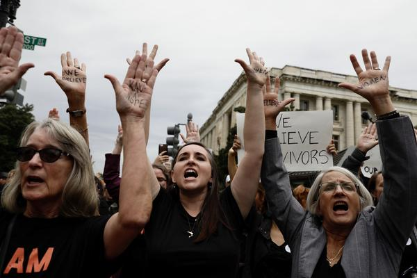Outside the Kavanaugh hearing, people protest.