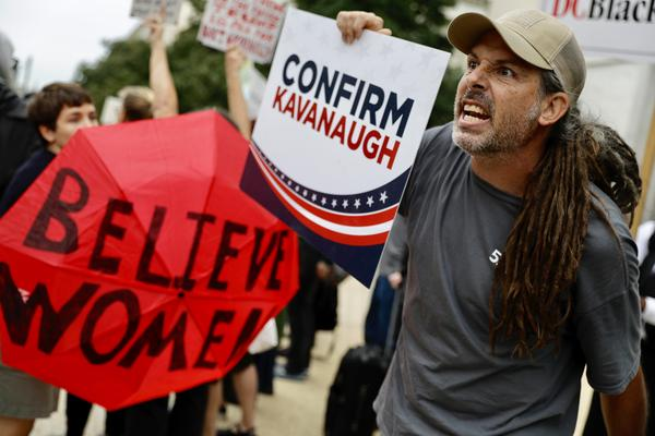 As the hearing goes on inside, a Kavanaugh supporter gets into an exchange of words with protesters.