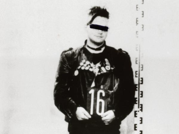 A young punk's Stasi arrest photo.