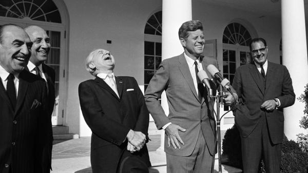 President John F. Kennedy enjoys a moment of levity at this Rose Garden ceremony marking Columbus Day, 1963.