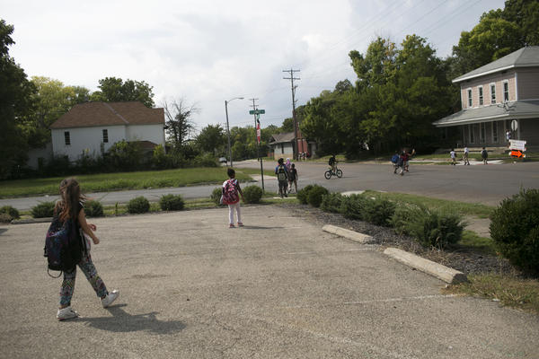 Kids walk home from school in Springfield. The city's population has fallen over the years. Now many young people go to college and leave the city.