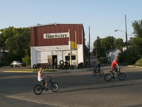 "Kids bike on Selma Road in Springfield, Ohio. ""Springfield is a rather typical small city that has grown poorer over the years,"" former mayor Roger Baker says."