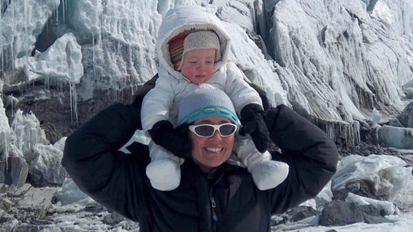 Lora Koenig with her son in the field at Russell Glacier in Greenland in 2011.
