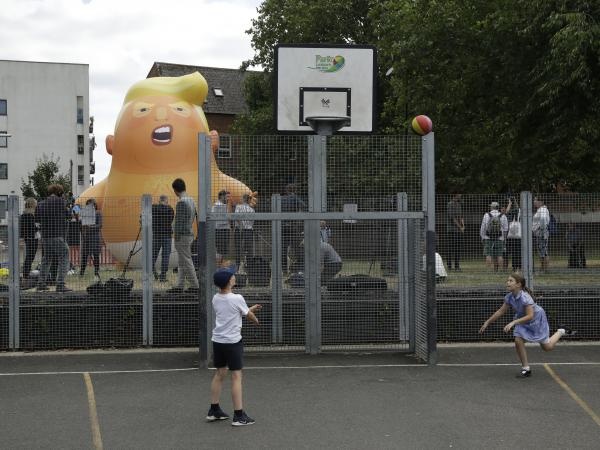 A 20-foot-tall blimp depicting President Trump as a cartoon baby stands inflated in London's Bingfield Park. It will hover above Parliament Square later this week during the president's visit.