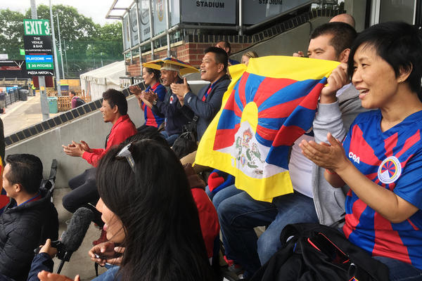 Tibetans cheer on a Tibetan team at a soccer tournament in London. Fans say they were pleased and surprised that the tournament organizers didn't succumb to pressure from potential sponsors and dump the Tibetan team to avoid angering the Chinese government.