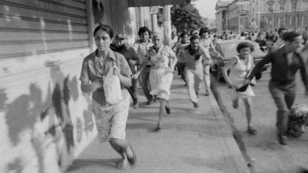 Leftist demonstrators flee after Salvadoran National Guard troops fire into a crowd of protesters on the steps of the San Salvador Cathedral on May 9, 1979.