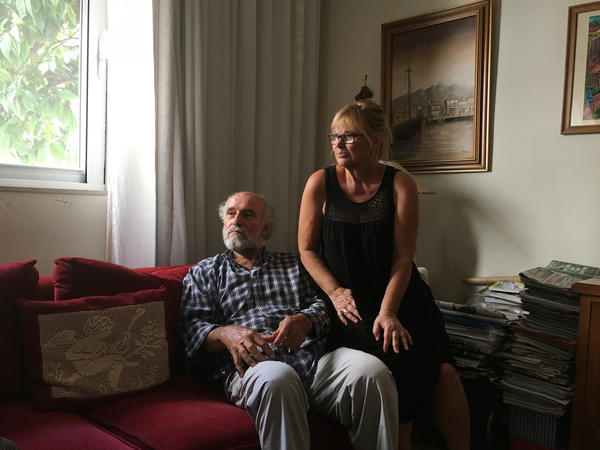 "Giorgos Nouchoutidis, shown at home with wife Maria, worked at the port of Piraeus for decades before retiring in 2010. ""It's a huge mistake for our government — and for the European Union — to have given up this port to the Chinese,"" he says."