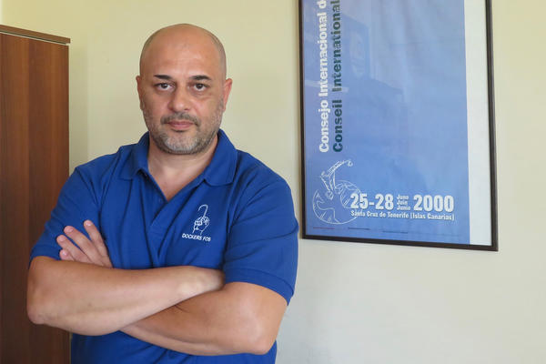 "Giorgos Gogos, the general secretary of the Piraeus port workers' union, calls the treatment of employees there ""exploitation."""