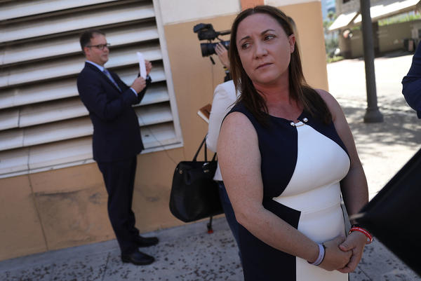 Lori Alhadeff and Ryan Petty, left, are seen in Fort Lauderdale, Fla., after turning in their paperwork to run for the Broward County School Board in May. Both parents had a 14-year-old daughter who was killed in the mass shooting at Marjory Stoneman Douglas High School in February.