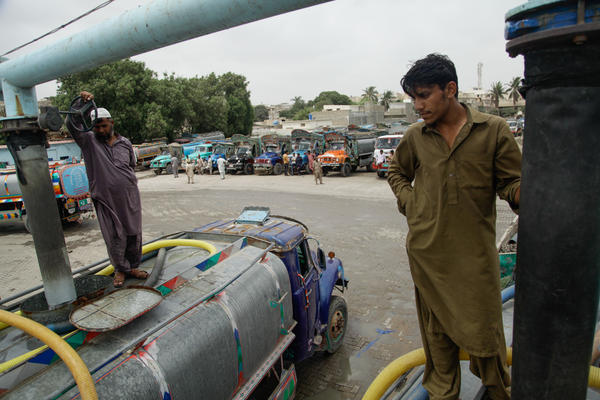 A water tanker driver fills his vehicle at a hydrant in Karachi.