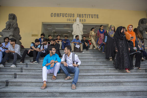 Abbas sits with another student, Wajahat Usmani, outside Islamabad's Chinese-run Confucius Institute, which is trying to teach Pakistani students about Chinese culture.