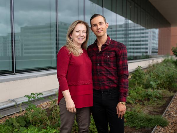 Adam Rippon and his mother Kelly Rippon pose together at NPR's headquarters in Washington, D.C.