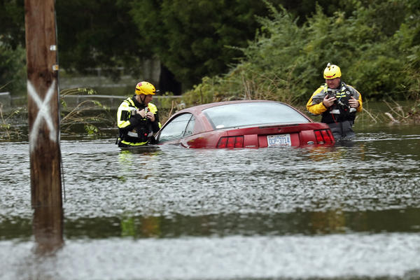 Members of a swift water rescue team check a submerged vehicle stranded in floodwaters caused by the tropical storm Florence in New Bern, N.C., on Sept. 15.