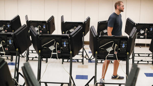 Voters cast their ballots in August among an array of electronic voting machines in a polling station at the Noor Islamic Cultural Center in Dublin, Ohio. The machines were manufactured by Elections Systems and Software, the largest manufacturer of voting equipment in the country.
