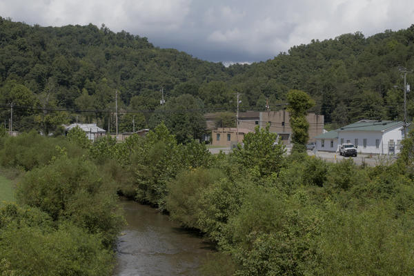 Rockcastle Creek flows past residential homes and businesses along Route 3 in the town of Inez in Martin County, Ky. People in Martin County still don't trust the tap water. The water issues in Martin County are multi-layered and it's hard to pinpoint exactly when they started.