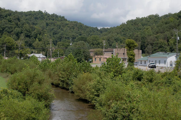 Rockcastle Creek flows past residential homes and businesses along Route 3 in the town of Inez, the county seat of Martin County, Ky. A giant coal sludge spill in October 2000 contaminated the county's rivers for miles, and locals still don't trust the water.