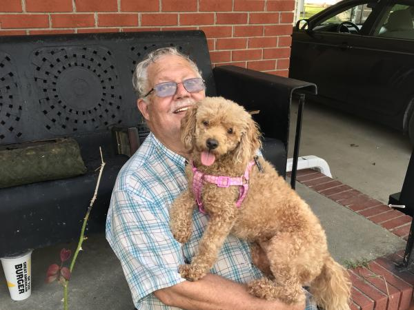 "Jerry Gray with his dog, Zoe, whom he also calls Sweetie and Hard Head. Zoe was the only pet his deceased wife, Hilda, would allow in their house. After losing his wife — and now his house — Gray says Zoe means everything to him. ""If I lost her, forget it,"" he says."