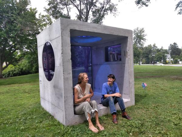 "Curator Sandy Litchfield, at left, and artist Sarah Braman sit inside Braman's ""Day Trip"" in Amherst, Massachusetts."
