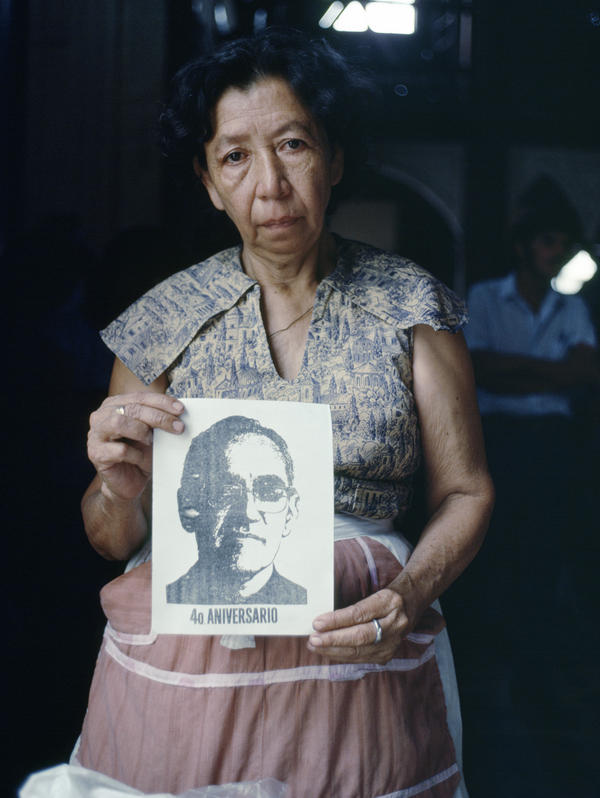 An unidentified woman in San Salvador holds a photocopied picture of Romero on the fourth anniversary of his death, March 24, 1984.