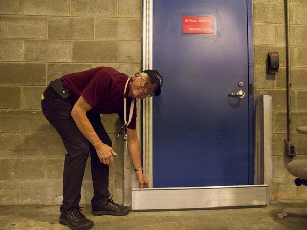 Raymond Scheinfeld, Philadelphia airport environmental manager, shows how sensitive electrical equipment can be protected from flooding.
