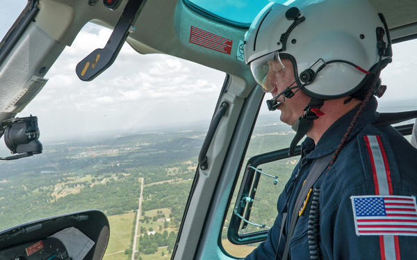 Chris Glascow, an Army veteran and pilot for Air Methods, flies over the border of Arkansas and Oklahoma.