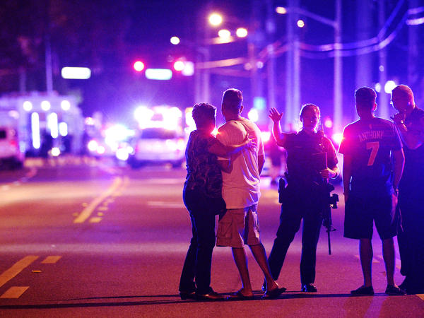 Orlando Police officers direct family members away from a fatal shooting at Pulse nightclub in Orlando, Fla. An investigation has found that a fire department plan to respond to mass shootings had been put on hold.