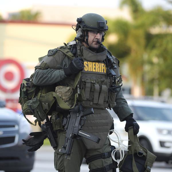 A Sheriff's Department SWAT member arrives to the scene of a fatal shooting at Pulse nightclub in Orlando, Fla. Bulletproof vests purchased for the fire department were never issued.