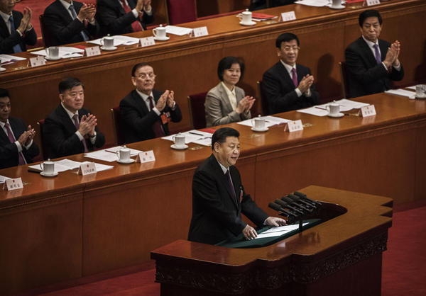 Xi, seen speaking to the National People's Congress in Beijing, is working to reform international institutions and norms to reflect the interests of the Chinese government.