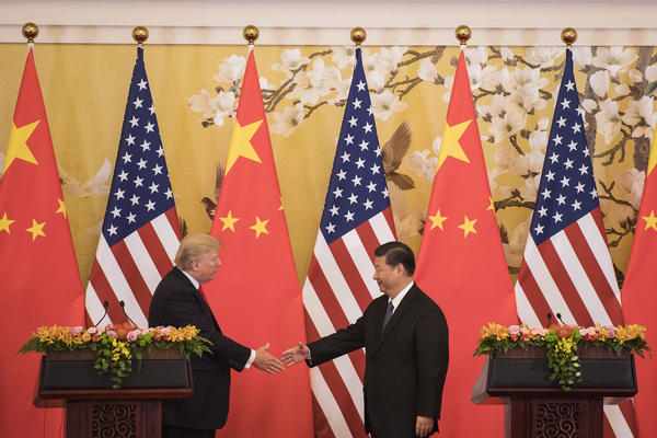 """Chinese President Xi Jinping shakes hands with President Trump during a joint statement in Beijing last November. Rather than a frontal assault on U.S. leadership, Xi has articulated his vision of a """"community of shared destiny."""""""
