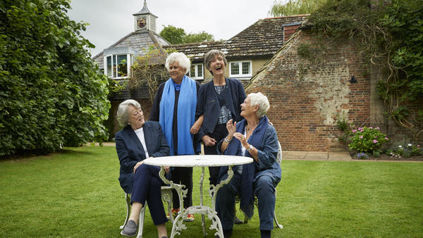 L to R: Dame Maggie Smith, Dame Joan Plowright, Dame Eileen Atkins and Dame Judi Dench spill the tea in <em>Tea with the Dames</em>.