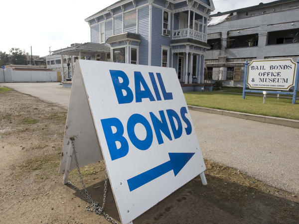 A bail bond office displays a sign near the Santa Ana Jail in Santa Ana, Calif. The most populous state in the nation passed a law to do away with money bail earlier this year.