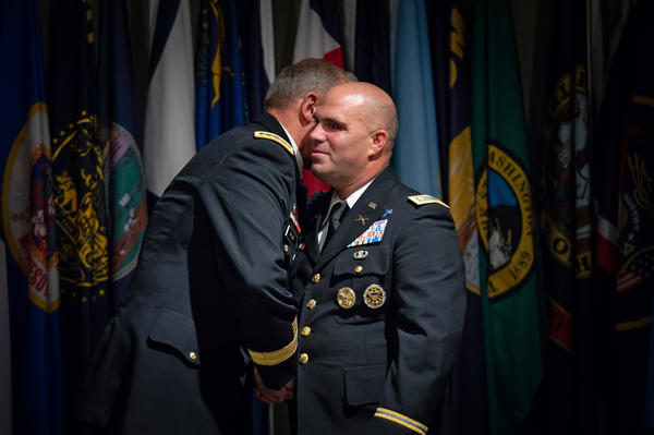 U.S. Army Pacific Commander Gen. Robert Brown shakes Skelton's hand during the retirement ceremony.