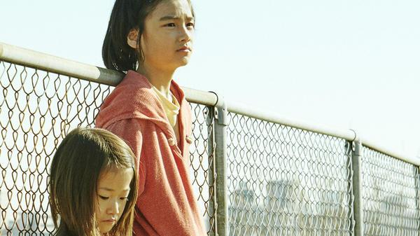 Miyu Sasaki and Jyo Kairi star in Hirokazu Kore-eda's <em>Shoplifters</em>.