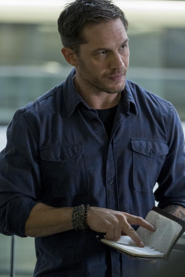 Tom Hardy stars as Eddie Brock — and the title alien symbiote — in <em>Venom</em>.