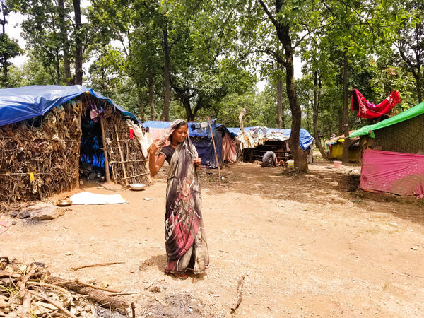 Nisha Devi lives in a rudimentary hut covered with a tarp near Ramgarh, in India's Jharkhand state. She believes hunger led to her uncle's recent death before he could get an Aadhaar card. The rest of the family has scrambled to enroll since his death, but Devi has been unable to draw welfare benefits so far.