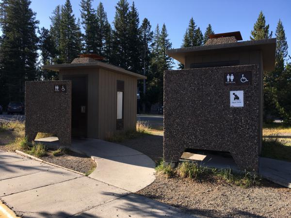 Visitors at West Thumb Geyser Basin in Yellowstone have two bathroom choices--a sitting toilet and squatting one.