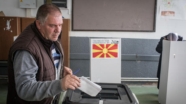 A man casts his vote at a polling station on Sunday in Tetovo, Macedonia. Macedonians all across the country went to the polls to vote in a referendum to change the country's name to the Republic of North Macedonia and end a long running dispute with Greece.