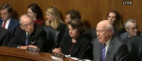 Vermont Democratic U.S. Senator Patrick Leahy addresses the Senate Judiciary Committee as Chair Chuck Grassley (R-IA) and Ranking Member  Dianne Feinstein (D-CA) look on.