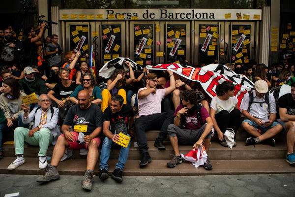 Independence supporters block the entrance of the Barcelona Stock Exchange on Monday, commemorating one year since the referendum that declared Catalonia independent — and that was immediately rejected by Spain's central government.