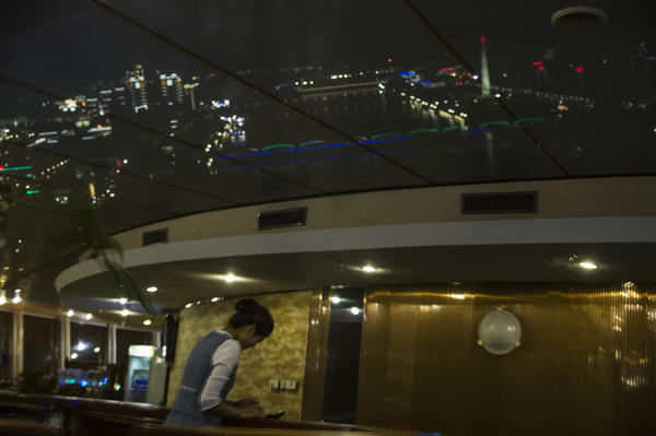 Pyongyang at night, as viewed from a revolving restaurant at the top of the Yanggakdo Hotel.