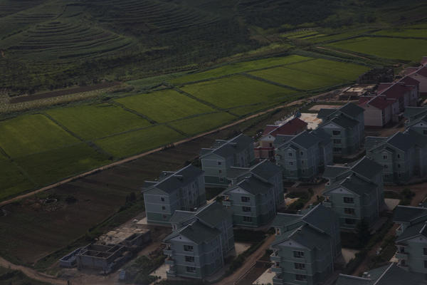 Apartments and a farm on the outskirts of Pyongyang, as seen from the air.