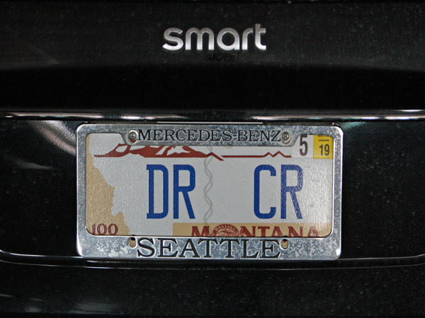"""Bartlett's license plate reflects her dedications to accounting. DR and CR are Latin abbreviations for """"debit"""" and """"credit"""" respectively."""