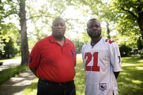 Andre Lewis and his friend and recovery sponsor William Roberts, who works in social services in Dayton and is a church pastor with nearly three decades clean.