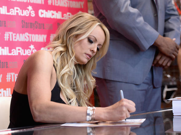 Stormy Daniels autographs a photo during a fan meet and greet at Chi Chi LaRue's on May 23 in West Hollywood, Calif.
