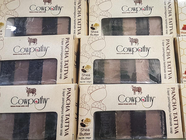 Boxes of soap from Cowpathy Care. Cow dung is dried and turned into a powder, then added to the bars.