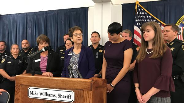 Left to Right: Joyce Mahr (CEO of the Betty Griffin Center), Gail Patin (CEO of Hubbard House), Ana Martinez-Mullen (CEO of Quigley House) & Lauren Goode (Outreach & Community Engagement Director at Micah's Place) flanked by law enforcement officials.