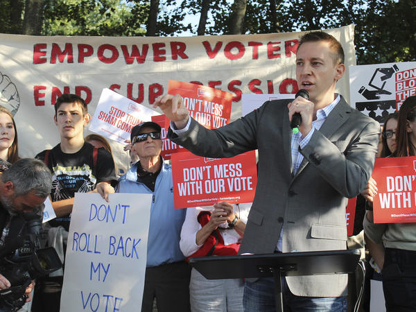 Jason Kander addresses a rally last year. He withdrew from the race for mayor of Kansas City, Mo., on Tuesday, saying he suffered from PTSD related to his military service in Afghanistan.