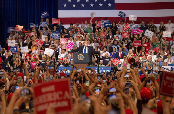 Trump urges a crowd to vote for Heller at a rally at the Las Vegas Convention Center on Sept. 20.