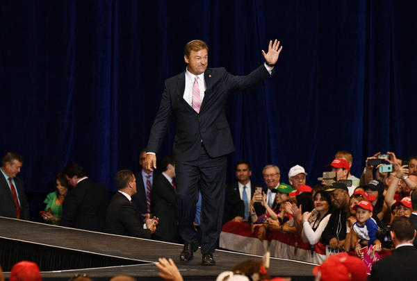 Dean Heller waves as he arrives at a rally with Trump (not pictured) in Las Vegas on Sept. 20. He is the only Republican in the Senate up for re-election in a state that Hillary Clinton won.