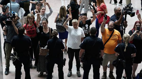 Activists chant during a protest outside the office of Senate Judiciary Committee Chairman Chuck Grassley of Iowa.